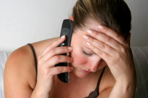 Image of woman on phone with a creditor